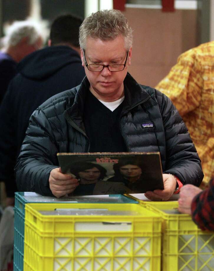 Steve Lackey, of Fairfield, peruses records during WPKN's MUSIC MASH Record Fair 2018 at Read's Artspace building on Broad Street in Bridgeport, Conn., on Friday, Mar. 2, 2018. MUSIC MASH 2018 featured 50+ vendors from all over New England selling vinyl LP's, 45's, CD's and music collectibles. Photo: Christian Abraham / Hearst Connecticut Media / Connecticut Post