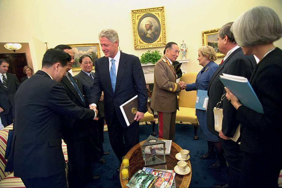 FILE-- In a photo provided by The White House, President Bill Clinton greets North Korean officials and North Korean Special Envoy Vice Marshal Jo Myong-rok shakes the hand of Secretary of State Madeleine K. Albright, following an Oval Office meeting at the White House, in Washington, in 2000. Now in 2018, if President Donald Trump meets Kim Jong-un, the son of the dictator who made a talks offer to Clinton, the challenge of verifying that North Korea is on the way to disarmament will be far, far greater than it was nearly two decades ago. (The White House via The New York Times) -- FOR EDITORIAL USE ONLY. -- Photo: DAVID SCULL, NYT