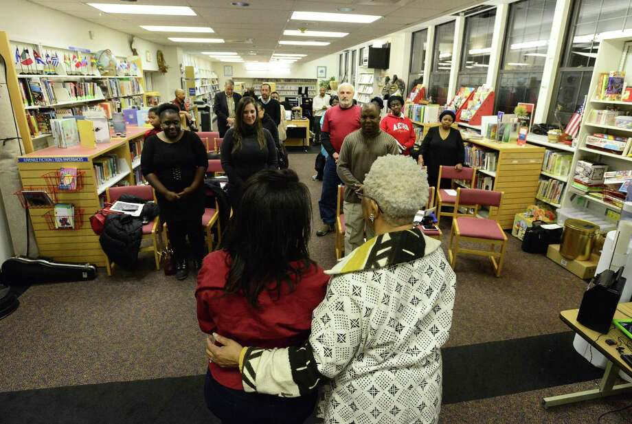 From left, Pascale Millien-Faustin stands with Josephine Fulcher-Anderson as they celebrate International Women's Day during a program at the Ferguson Library South End Branch in Stamford, Conn. on Thursday, March 8, 2018. The event brought together awareness and support for women's rights and participation. It was co-sponsored by the Ferguson Library South End Branch and UNESCO Center for Global Friendship, Inc. Photo: Matthew Brown / Hearst Connecticut Media / Stamford Advocate