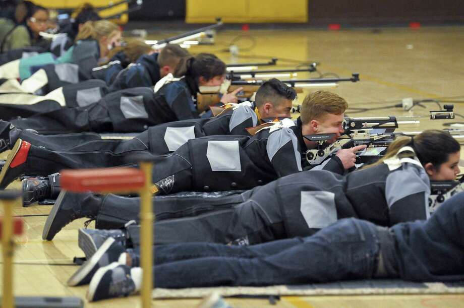 In this March 2, 2018 photo, a group of JROTC shooters compete in the prone position during the 2018 New Mexico Junior Olympic Qualifier for sport and precision air rifles at Cibola High School in Albuquerque, N.M., for the chance to compete at the National Junior Olympic Championships in Ohio in June. The National Rifle Association has given more than $7 million in grants to hundreds of U.S. schools in recent years, typically used for JROTC programs, including $126,000 given to Albuquerque schools. Photo: Marla Brose /Associated Press / The Albuquerque Journal