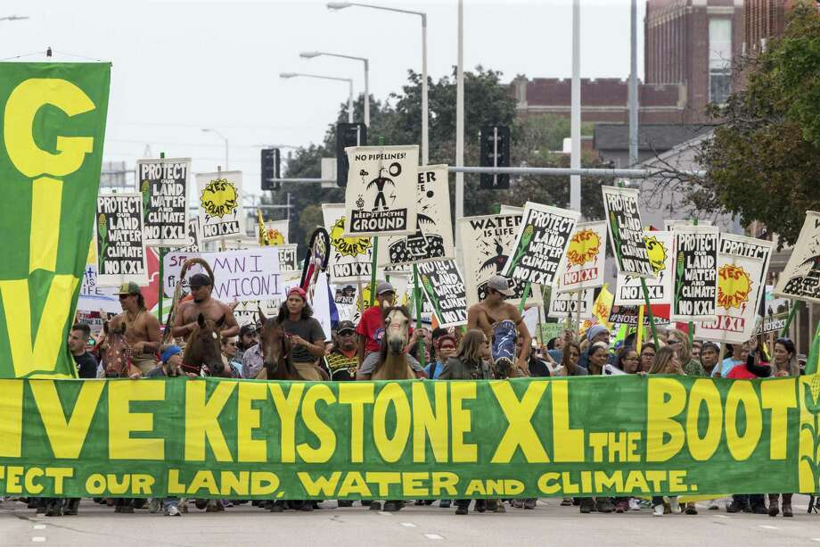 In this Aug. 6, 2017, file photo, demonstrators against the Keystone XL pipeline march in Lincoln, Neb. The developer of the Keystone XL pipeline doesn't have to reimburse attorneys who defended Nebraska landowners against the company's efforts to gain access to their land, the state Supreme Court ruled Friday. Photo: Nati Harnik /Associated Press / Copyright 2017 The Associated Press. All rights reserved.