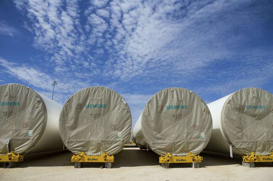 Wind turbine components sit in a freight yard waiting to be moved further inland at the Port of Corpus Christi, Wednesday, March 7, 2018, in Corpus Christi. ( Mark Mulligan / Houston Chronicle ) Photo: Mark Mulligan, Houston Chronicle / Houston Chronicle / © 2018 Houston Chronicle