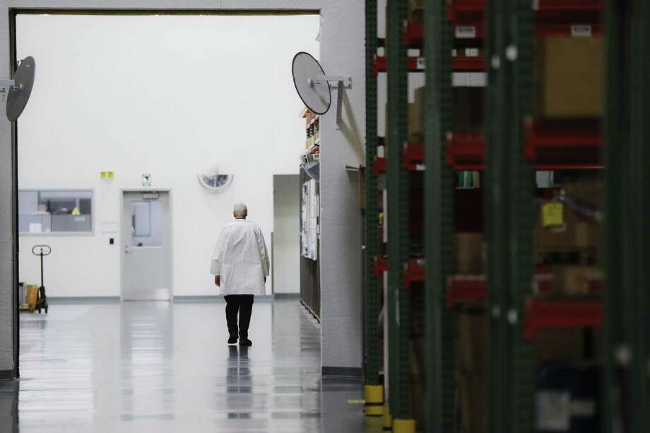 In this Oct. 24, 2017, photo, an employee walks off the manufacturing floor while wearing his laboratory coat at Lord Corporation, a manufacturer of industrial coatings, adhesives, bearings, and sensing equipment for range of commercial markets, including United States military contracts in Erie, Pa. Since 2008, Erie has suffered a hidden and potentially more devastating exodus: The loss of well-paid white-collar jobs. The city has shed 8 percent of its accountants, 10 percent of its computer workers, 40 percent of its engineers and 20 percent of its lawyers, according to government occupational data analyzed by The Associated Press. Photo: John Minchillo /Associated Press / AP