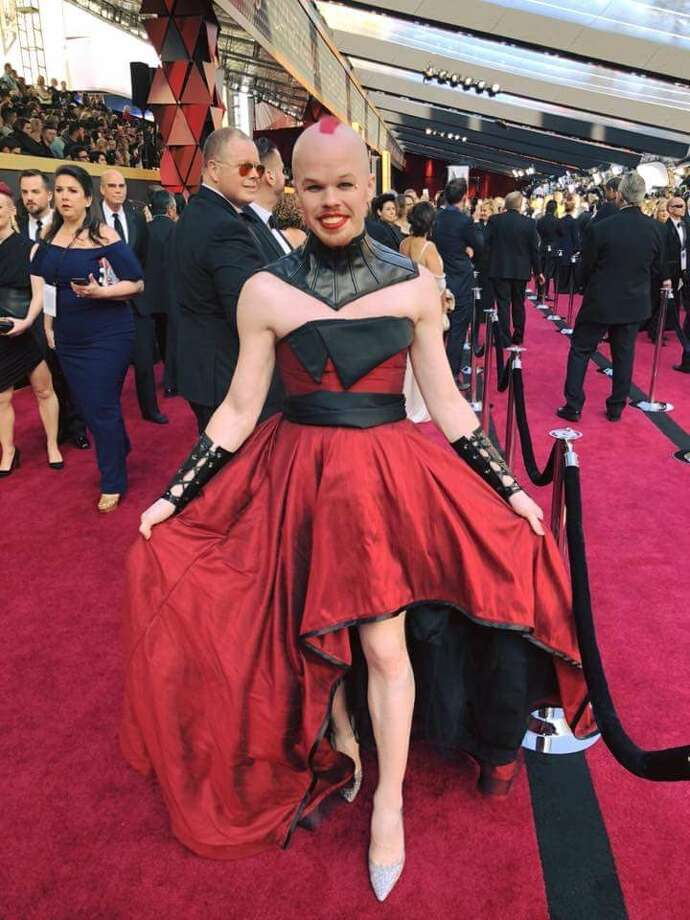 Woodlands resident Romy McCloskey, a renowned couture costume designer who runs Faden Design Studios, designed and created a dress for Oscar guest Sam Brinton, a LBGTQ activist who is head of Advocacy and Government Affairs for The Trevor Project, a nonprpofit suicide prevention hotline for lesbian, gay, bisexual, transgender and questioning youth. Brinton is shown here on the Red Carpet at the Academy Awards. Photo: Courtesy Photo