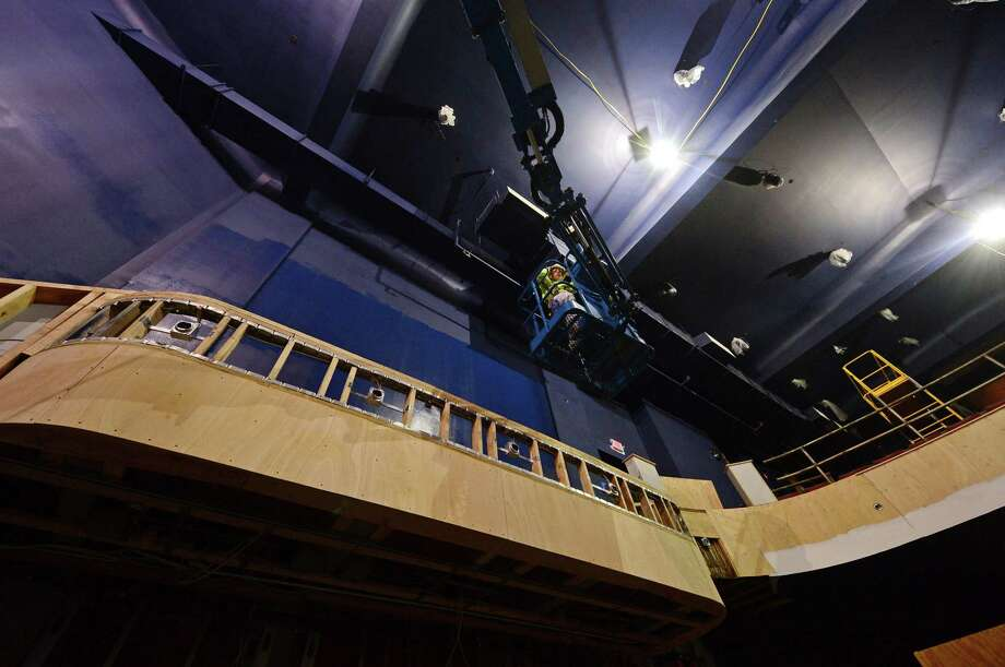 Workers build balcony seating in February 2017 at the Wall Street Theater in Norwalk, Conn. In a February 2018 bankruptcy filing, the theater described its financing mechanism that relied on the promise of cash produced through the resale of tax credits to service debt it took on from Patriot Bank in Stamford. Photo: Erik Trautmann / Hearst Connecticut Media / Norwalk Hour