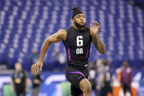 Auburn defensive back Carlton Davis runs the 40-yard dash at the 2018 NFL Scouting Combine on Monday, March 5, 2018, in Indianapolis. (AP Photo/Gregory Payan)