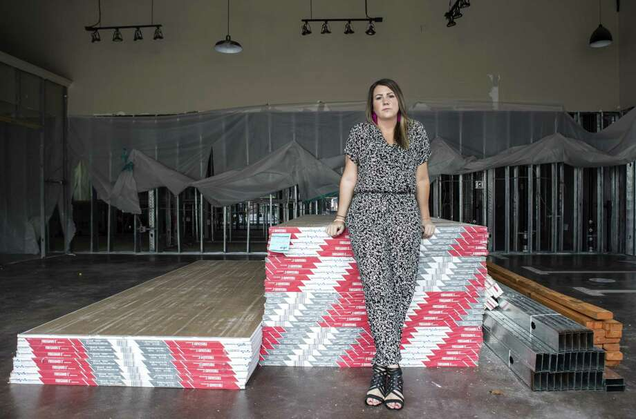 Nikole Davis poses for a portrait in the shell of Pretty Little Things boutique in the Kings Harbor mixed-use development on Thursday, Feb. 22, 2018, in Kingwood. Davis' store took on six feet of water in the aftermath of Hurriane Harvey. Davis opened a pop-up shop, in nearby Atascocita, and expanded her online business to keep selling her merchandise while she rebuilds her store. ( Brett Coomer / Houston Chronicle ) Photo: Brett Coomer, Staff / Houston Chronicle / © 2018 Houston Chronicle