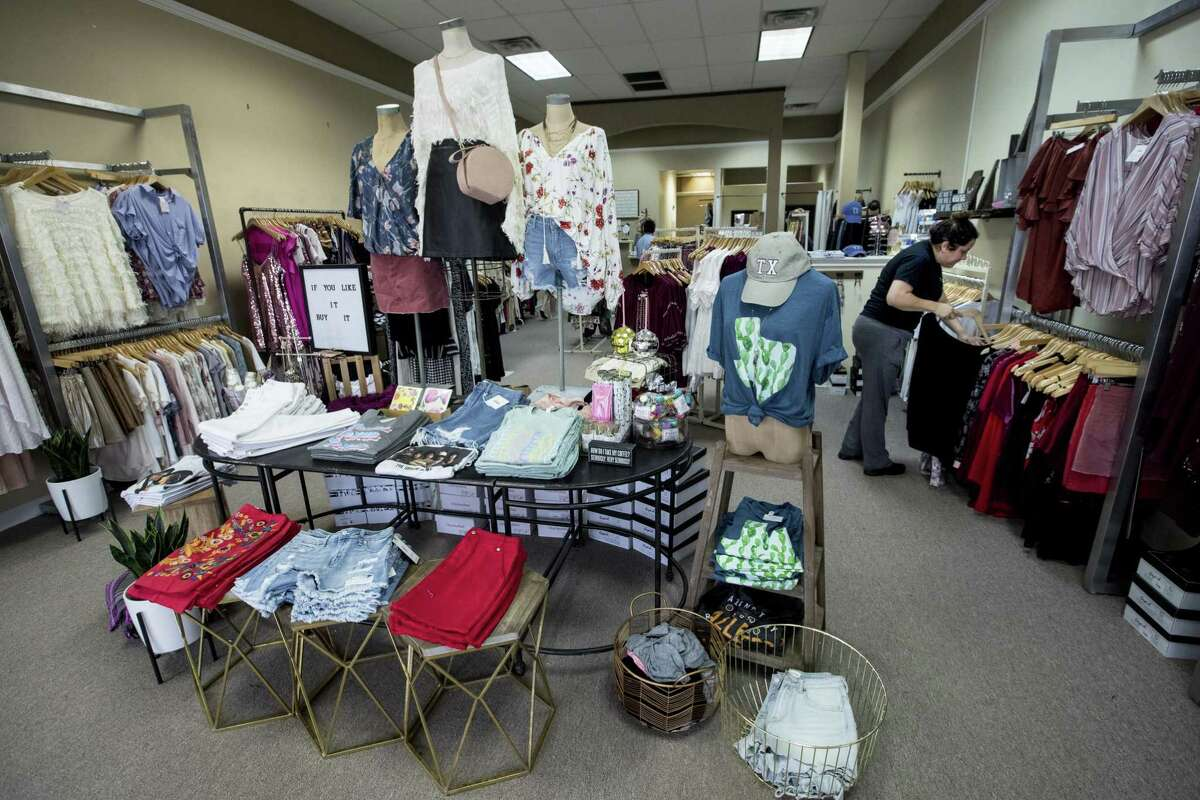 Amanda Villarreal, right, shops in Nikole Davis' Pretty Little Things pop-up store on Thursday, Feb. 22, 2018, in Atascocita. Davis' Kingwood store took on six feet of water in the aftermath of Hurriane Harvey. She opened a pop-up shop, in nearby Atascocita, and expanded her online business to keep selling her merchandise while she rebuilds her store. ( Brett Coomer / Houston Chronicle )