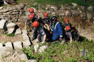 Photos provided by the San Antonio Fire Department show efforts by firefighters to rescue a teenage girl from Robber Baron Cave Thursday, March 8, 2018.