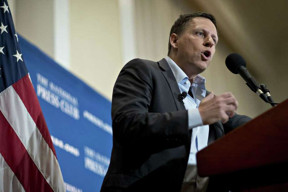 FILE-- Peter Thiel, co-founder of PayPal, speaks at a news conference at the National Press Club in Washington, D.C., on Oct. 31, 2016. Cambridge Analytica later developed a relationship with a Palantir staffer that produced the idea to use an app to harvest Facebook user data. Photo: Andrew Harrer/Bloomberg / Bloomberg