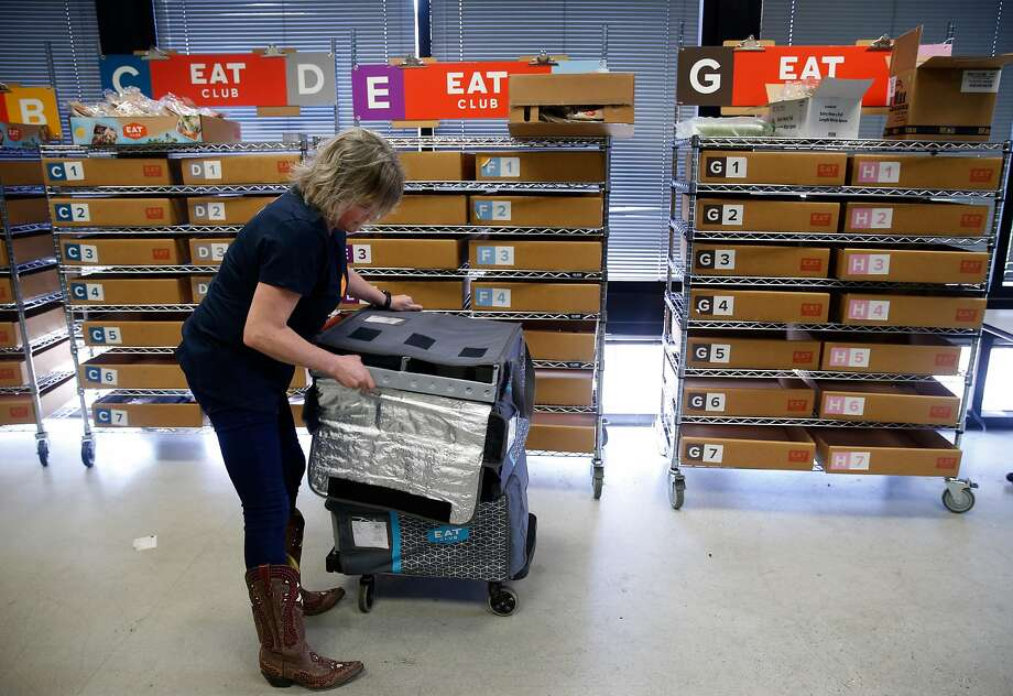 Kerry Camph delivers 250 lunches from Eat Club for employees at Coupa Software in San Mateo. Photo: Paul Chinn, The Chronicle
