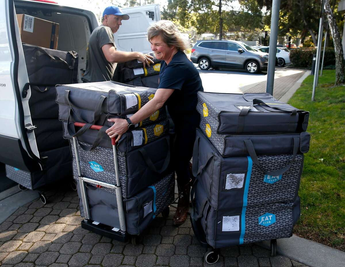 Kerry Camph and Steve Friis unload 250 lunches ordered online and delivered from EAT Club to employees at Coupa Software in San Mateo, Calif. on Thursday, March 8, 2018.