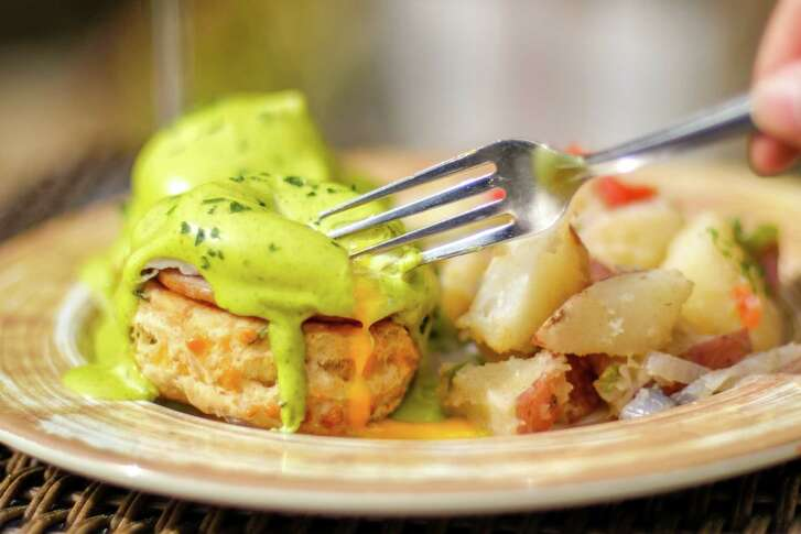 King's BierHaus, 2044 E. T.C. Jester, will start serving Sunday brunch on March 11. Shown: King's Benedict made with house-made cheddar chive biscuit, Canadian bacon, poached cage-free eggs and dill hollandaise.