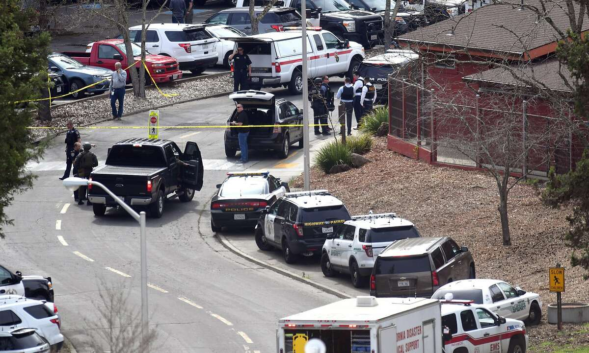 Law enforcement personnel gather near the scene where an active shooter has taken hostages at the Veteran Administration Hospital in Yountville, California on Friday, March 09, 2018.