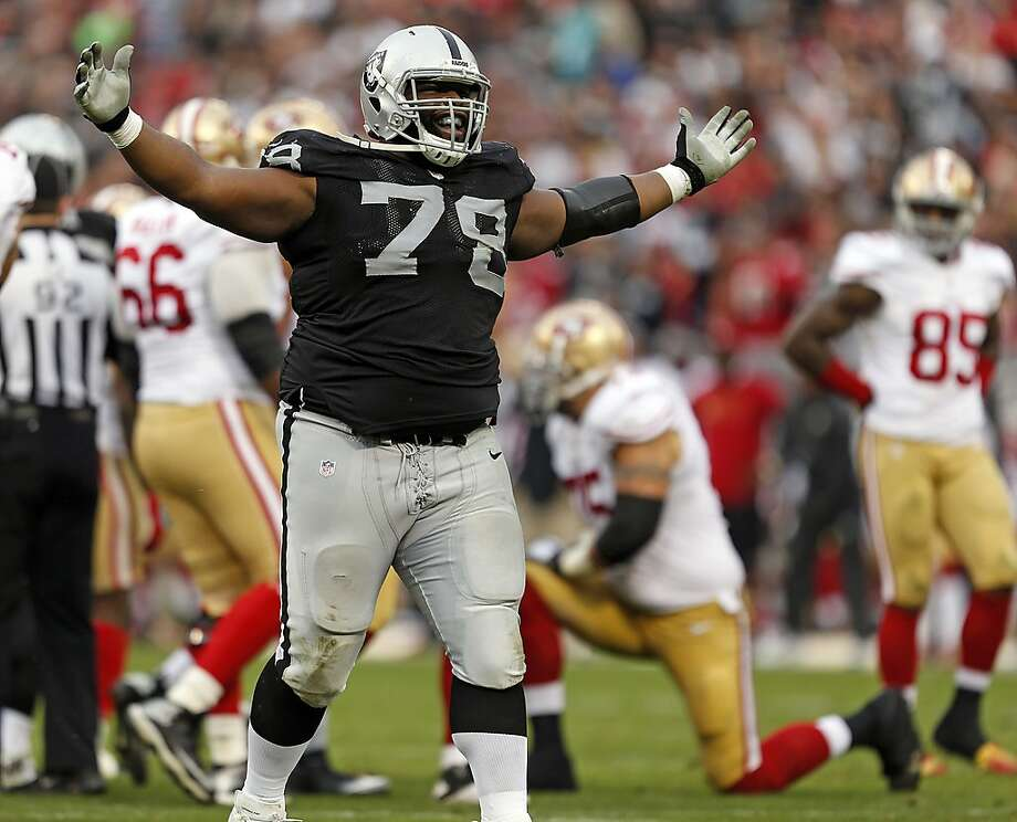 Oakland Raiders' Justin Ellis celebrates a sack of San Francisco 49ers' Colin Kaepernick in 4th quarter of Raiders' 24-13 win in NFL game at O.co Coliseum in Oakland, Calif., on Sunday, December 7, 2014. Photo: Scott Strazzante / The Chronicle 2014