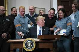 President Trump speaks before signing proclamations on aluminum and steel tariffs at the White House on Thursday. MUST CREDIT: Washington Post photo by Jabin Botsford