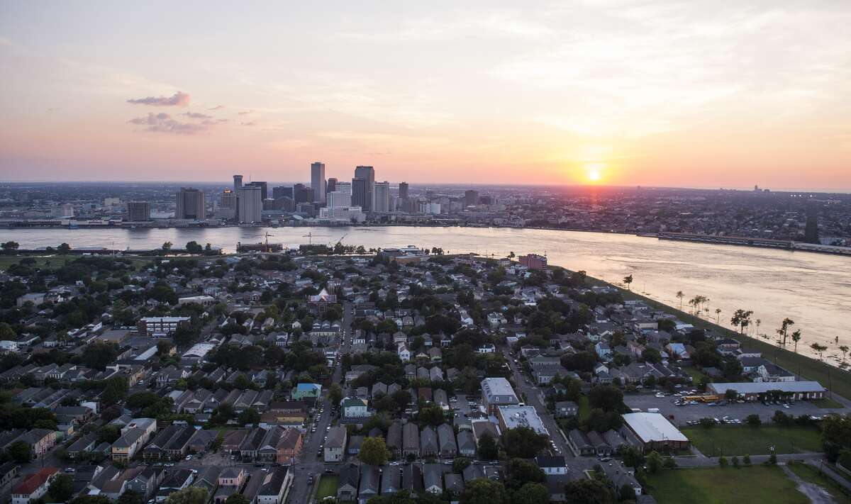 : An aerial view of the Algiers neighborhood in the foreground with the downtown skyline on August 1, 2015 in New Orleans, La. (Photo by Ricky Carioti/The Washington Post via Getty Images)