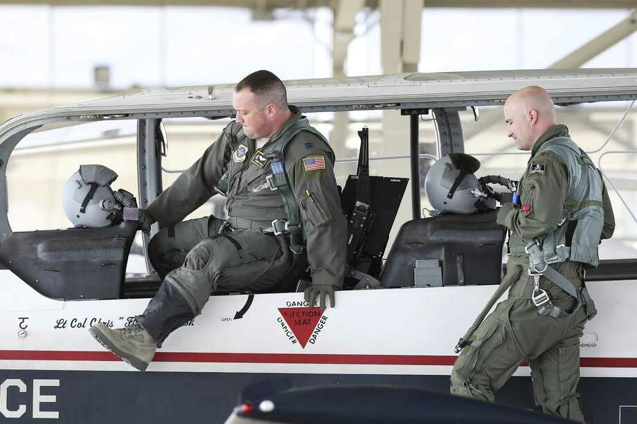 Pilots lift themselves into the cockpit as crews prepare to fly T-6A aircraft at Joint Base San Antonio-Randolph on March 2, 2018. Photo: Photos By Tom Reel / San Antonio Express-News / 2017 SAN ANTONIO EXPRESS-NEWS