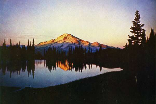 Photographic postcard of Glacier Peak at dawn with lake in foreground Notes: Glacier Peak and Image Lake at dawn, part of a great wilderness parkland, the North Cascades of Washington.