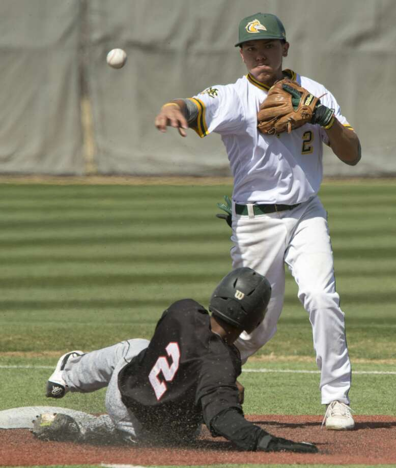 Midland College's Frainyer Chavez gets the force out at second on Howard College's Jaxon Williams and makes the double play to first 03/09/18 in the first game of a double header at Christensen Stadium. Tim Fischer/Reporter-Telegram Photo: Tim Fischer/Midland Reporter-Telegram