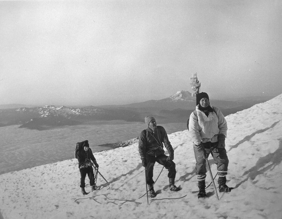 Environment used to be a Republican cause.  Image shows Governor Dan Evans, Frank Pritchard, Jr. and George Senner as they climb Mount Rainier. Bill Bell likely took the photograph. As they climb the slope, Mount Adams rises in the distance to the south. 1965.