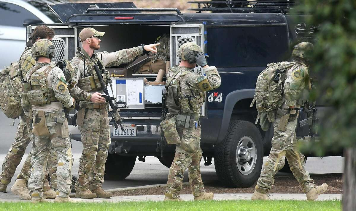 Law enforcement personnel move towards the scene where an active shooter has taken hostages at the Veteran Administration Hospital in Yountville, California on Friday, March 09, 2018.