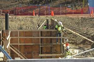 Workers put together concrete forms for a foundation on the Construction site of new community center and senior center on the Fairfield Hills campus in Newtown, Conn, on Tuesday afternoon, March 6, 2018.