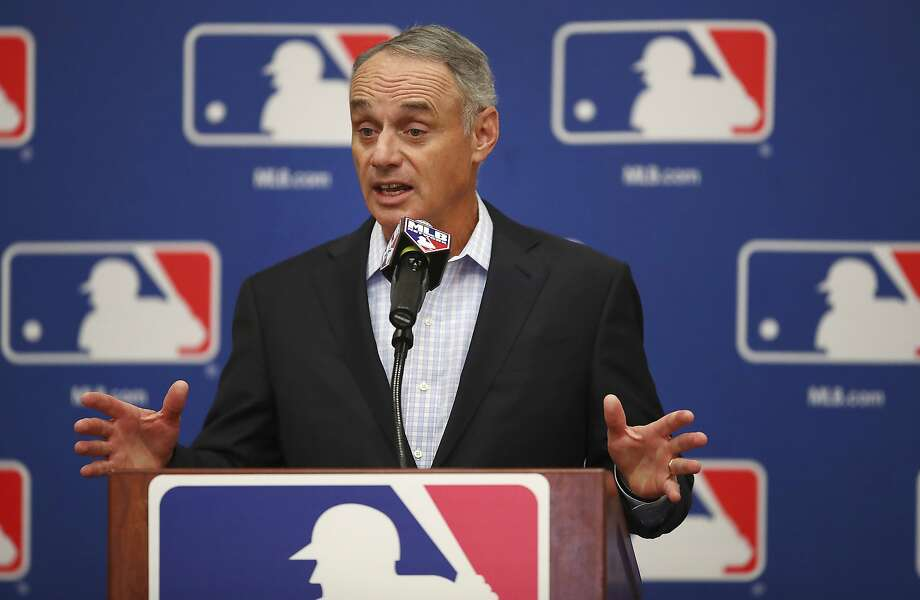 FILE - In this Feb. 20, 2018, file photo, Major League Baseball Commissioner Rob Manfred gestures while speaking at an owners meeting in Glendale, Ariz. Facebook is getting deeper into the professional sports streaming game, signing a deal with Major League Baseball to show 25 afternoon games in an exclusive deal. The games will be available Facebook users in the U.S. on Facebook Watch, the company's video feature, via the MLB Live show page Facebook said Friday, March 9. (AP Photo/Ben Margot, File) Photo: Ben Margot, Associated Press