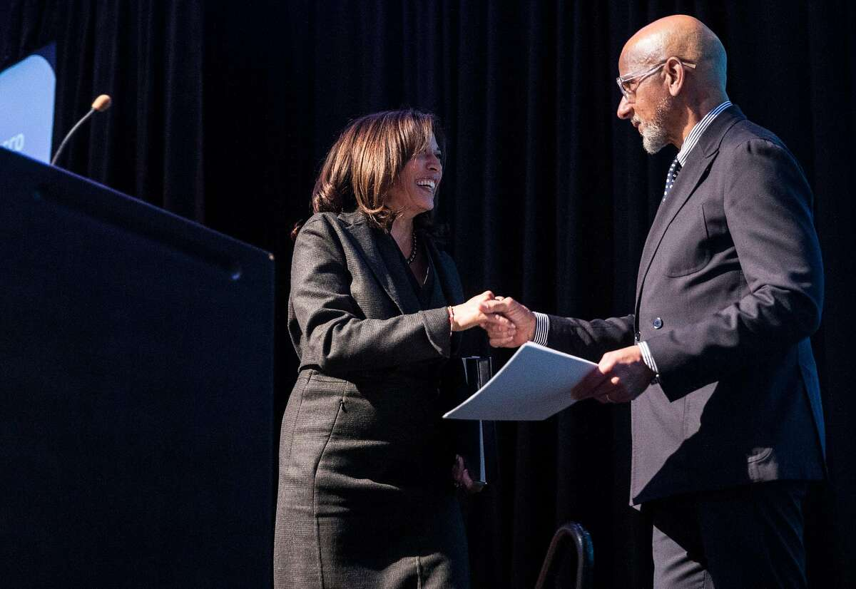 U.S. Senator Kamala D. Harris shakes hand with YMCA President and CEO Charles Collins after being introduced during the Y for Youth luncheon hosted by the YMCA at Yerba Buena Center for the Arts Friday, March 9, 2018 in San Francisco, Calif.