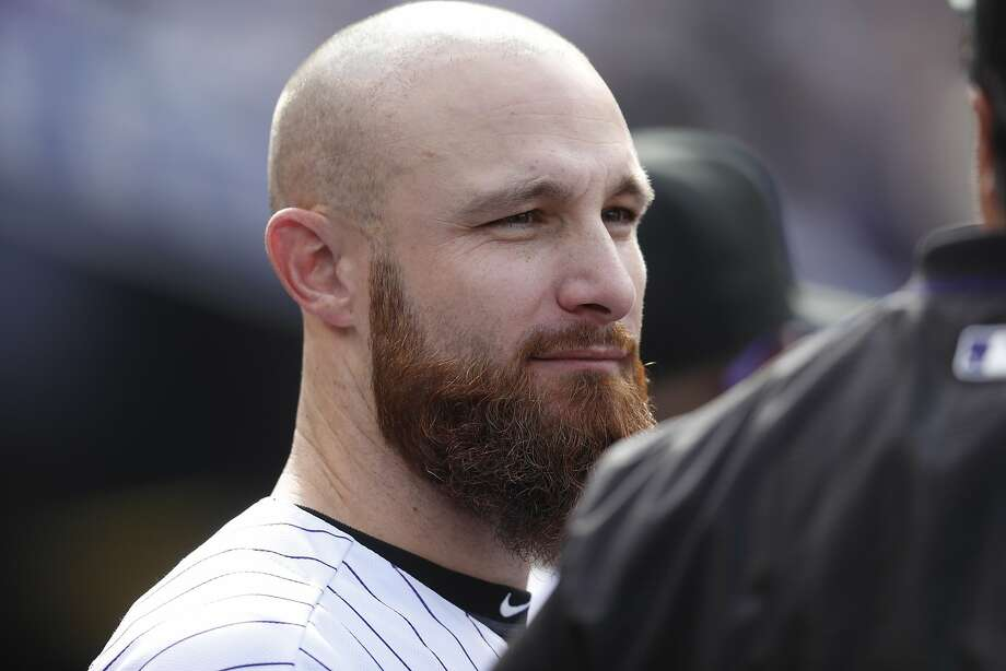 FILE - In this Oct. 1, 2017, file photo, Colorado Rockies catcher Jonathan Lucroy (21) is shown during the fourth inning of a baseball game against the Los Angeles Dodgers, in Denver. In a historically slow market, players and management are feuding publicly about riches and rules, and teams seemingly are seeking bargains like shoppers awaiting a closeout.  Job-seekers include pitchers Alex Cobb and Lance Lynn; reliever Greg Holland; infielder Eduardo Nunez; outfielders Carlos Gomez and Carlos Gonzalez; and catcher Jonathan Lucroy. (AP Photo/David Zalubowski, File) Photo: David Zalubowski, Associated Press