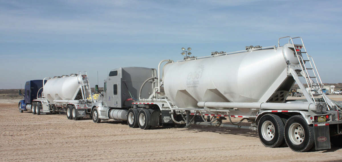 Trucks leave High Roller Sand's sand mine in Kermit in this file photo. Analysis by the Texas Independent Producers and Royalty Owners Association shows commercial drivers' licenses are the top qualification in new job postings.