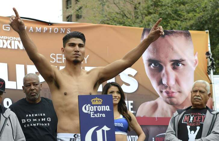Mickey Garcia (37-0, 30 KOs) gestures during his weigh-in for his junior welterweight title bout vs. Sergey Lipinets (13-0, 10 KOs).