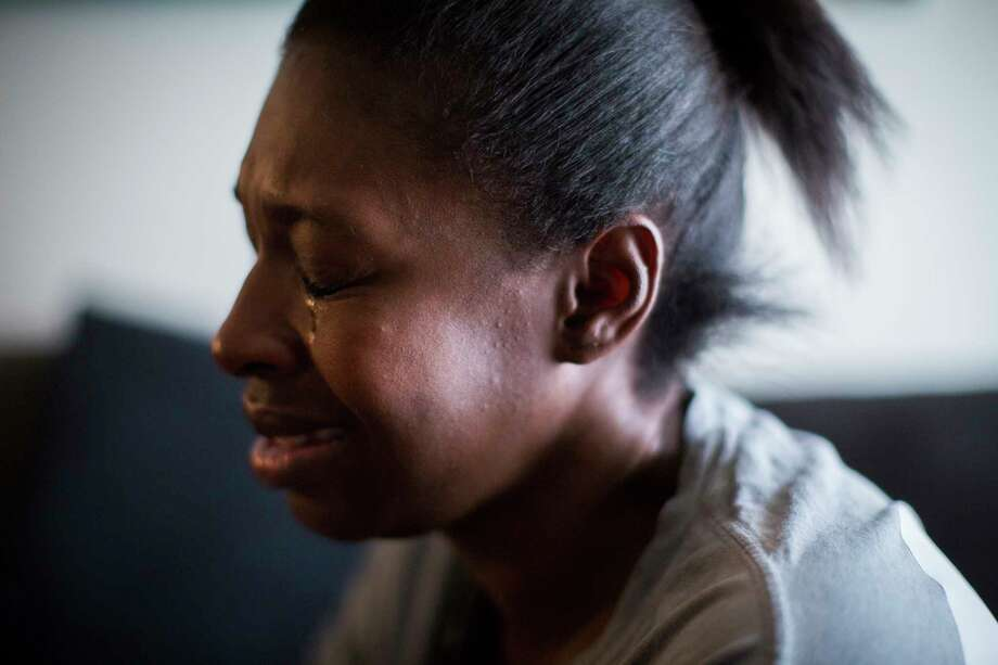 Joyel McCardell cries for her son Justin Gooden, a 6-year old boy who unintentionally shot himself with a gun he found in a bedroom at his sister's apartment. Tuesday, Feb. 13, 2018, in Houston. Photo: Marie D. De Jesus, Houston Chronicle / © 2018 Houston Chronicle