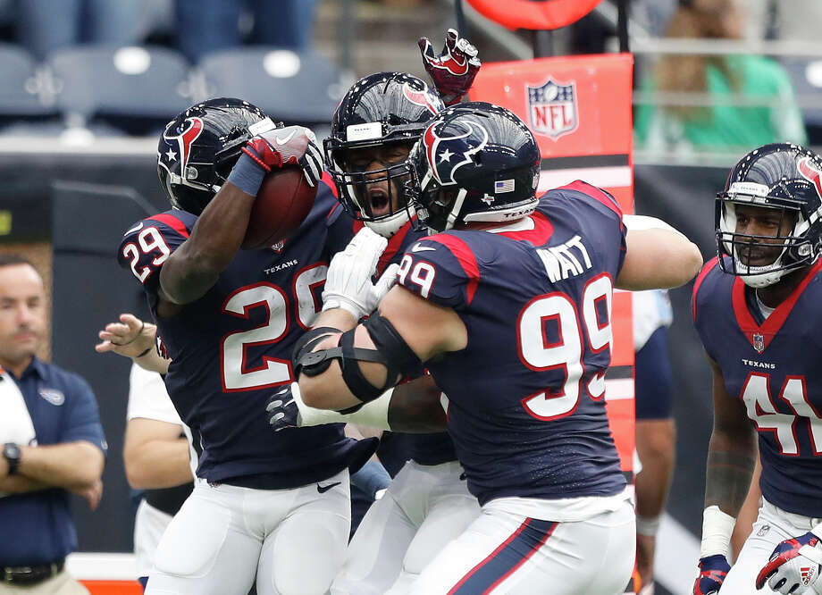 Houston Texans defensive end J.J. Watt (99) and Houston Texans free safety Andre Hal (29) celebrate an interception during the first quarter of an NFL football game at NRG Stadium, Sunday, Oct. 1, 2017, in Houston.   ( Karen Warren / Houston Chronicle )For a look at the top 10 teams in terms of salary-cap flexibility, browse through the gallery. Photo: Karen Warren/Houston Chronicle