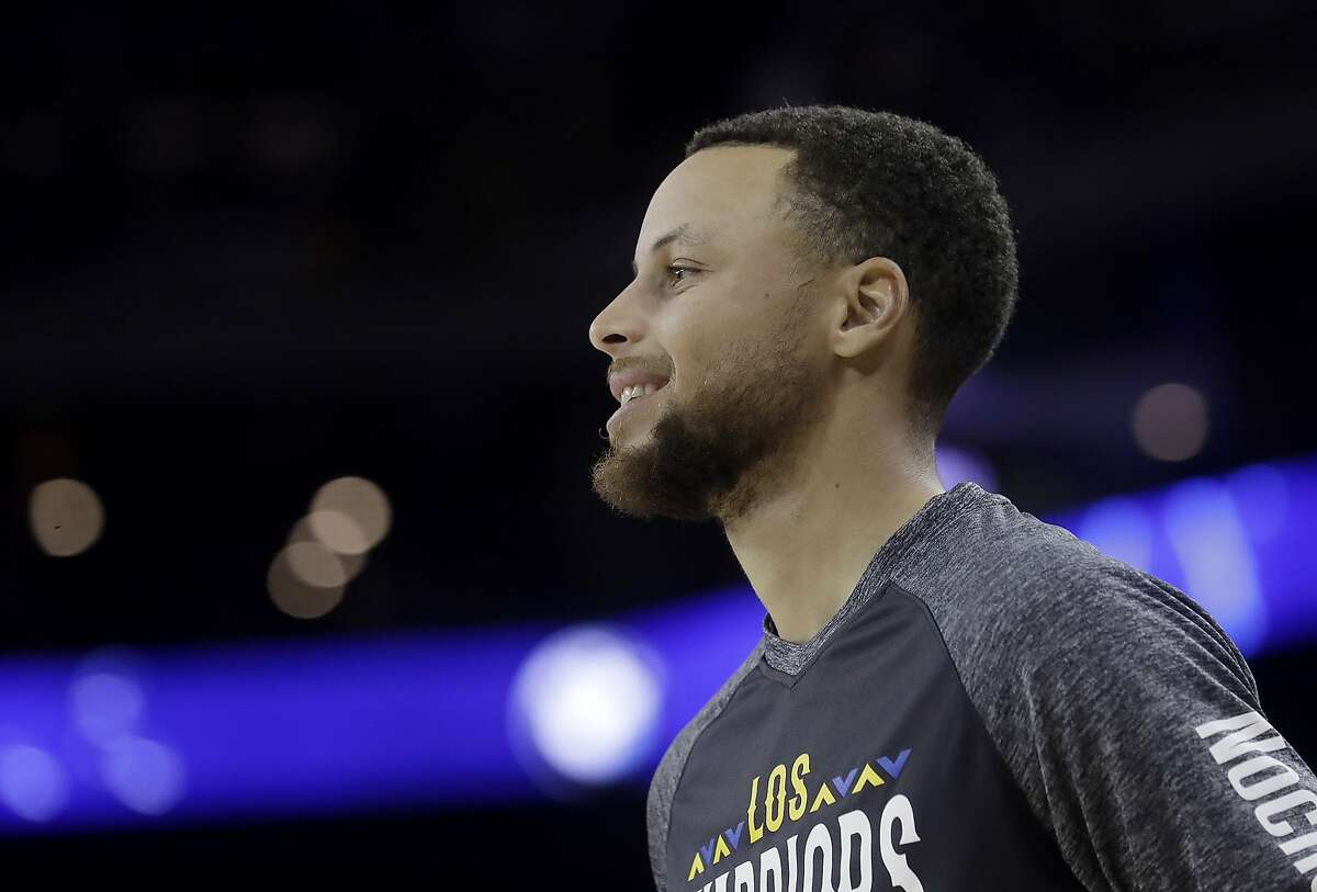 Golden State Warriors guard Stephen Curry before an NBA basketball game against the San Antonio Spurs in Oakland, Calif., Thursday, March 8, 2018. (AP Photo/Jeff Chiu)
