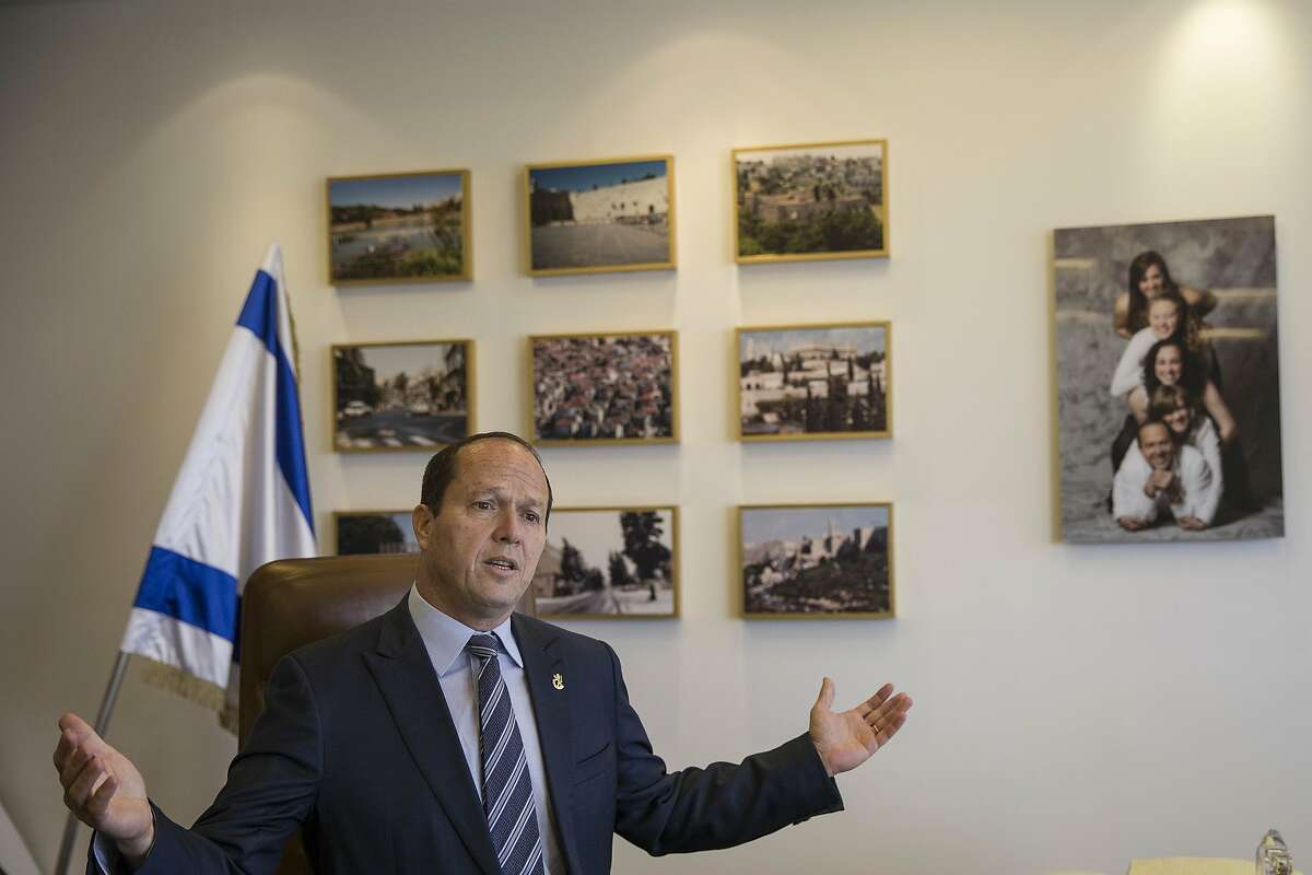 Jerusalem Mayor Nir Barkat speaks during an interview with The Associated Press in Jerusalem, Tuesday, Feb. 27, 2018. Barkat said Tuesday that he was working with a third party to resolve a tax dispute with major Christian denominations that has led to the closure of the Church of the Holy Sepulchre, one of Christianity's holiest sites, just ahead of the busy Easter season. Later Tuesday, the mayor suspended plans to collect taxes from churches. (AP Photo/Tsafrir Abayov)