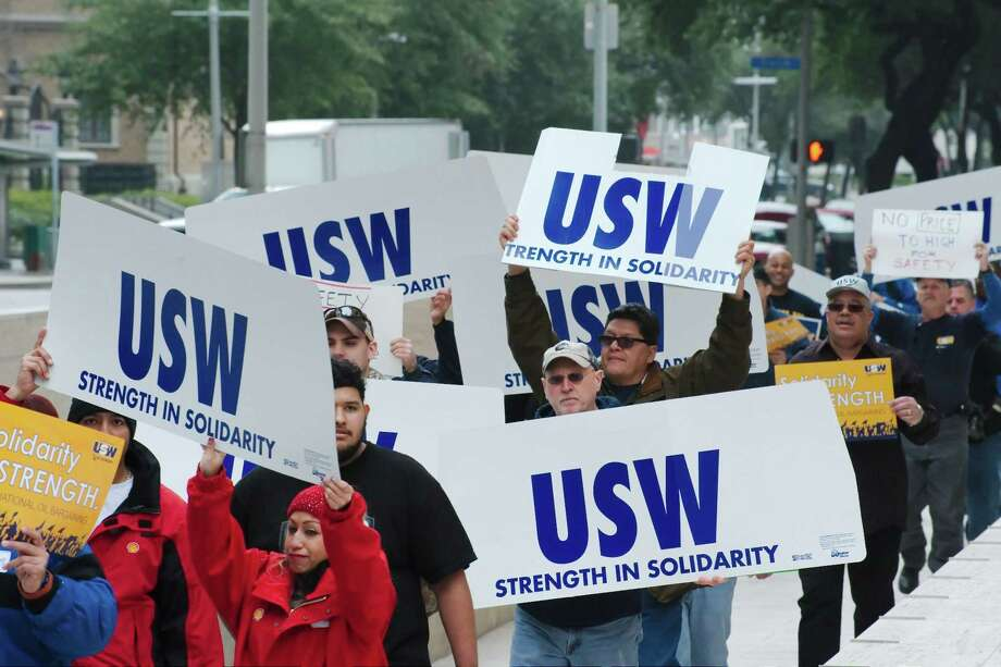 Representatives from the United Steel Workers Union (USW) march around the Shell Corporation headquarters at One Shell Plaza in Houston last year during a rally calling for a fair contract that would end a current strike at nine U.S. refineries and chemical plants in California, Kentucky, Texas and Washington. The right to organize is a basic right that should be honored in San Antonio. Photo: Kirk Sides / / Internal