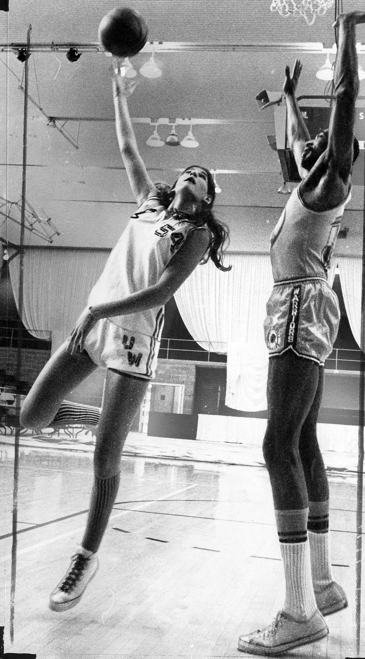 Denise Long, drafted by the Warriors in the 13th round. The NBA disallowed the pick, shown here shooting over Nate Thurmond, June 6, 1969 Photo ran 06/07/1969, p. 36