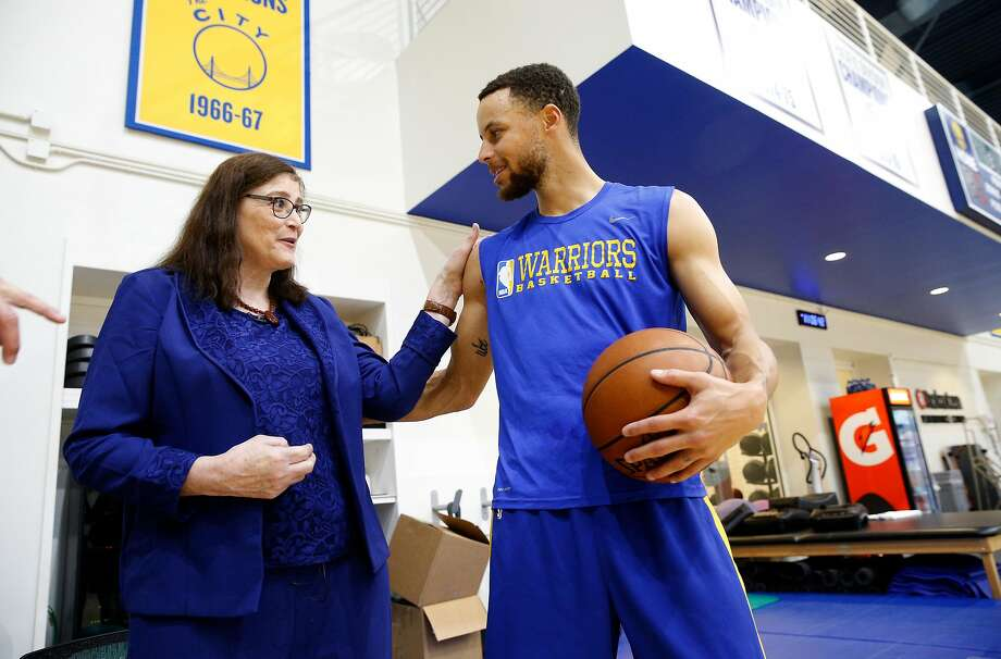 Denise Long, with NBA star Stephen Curry at the Warriors' practice Thursday, averaged 69.6 points as a high-schooler. Photo: Michael Macor, The Chronicle