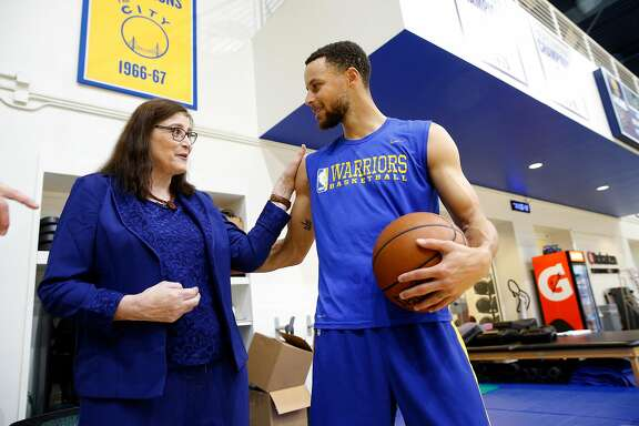 Denise Long visits with Stephen Curry during a recent Golden State Warriors' practice session. Long, after graduating from High School was drafted by the Golden State Warriors to play on their women's exhibition team. She got the chance to visit with players and see a Golden State Warriors' practice, on Thurs. March 8, 2018, in Oakland, Calif.