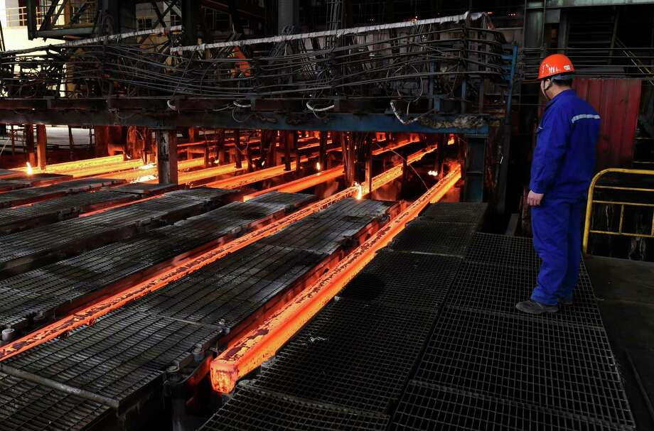 A Chinese employee watching red hot steel at a steel plant in Zouping in China's eastern Shandong province. China is the supposed target of tariffs on steel and aluminum but only about 3 percent of U.S. steel imports and 6 percent of aluminum imports come from China. Photo: - /AFP /Getty Images / AFP or licensors