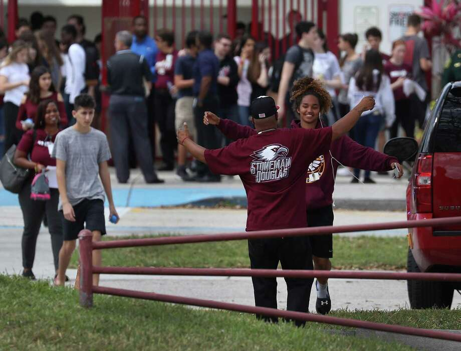 Marjory Stoneman Douglas High School students return to school on February 28, two weeks after the mass shooting that killed 17. Readers discuss the tragedy — and what can be done to prevent future tragedies. Photo: Joe Raedle /Getty Images / 2018 Getty Images