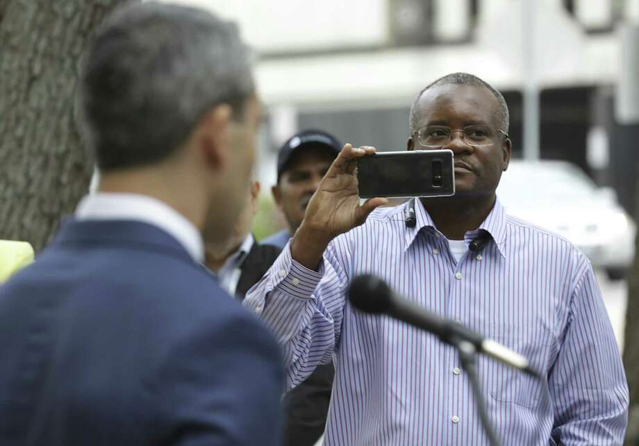 San Antonio Professional Fire Fighters Union President Chris Steele (right) records a recent address Mayor Ron Nirenberg on made on the steps of City Hall. A reader says Steele should have better things to do than try to amend the city charter. Photo: Bob Owen /San Antonio Express-News / ©2018 San Antonio Express-News