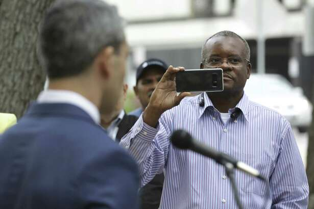 San Antonio Professional Fire Fighters Union President Chris Steele (right) records a recent address Mayor Ron Nirenberg on made on the steps of City Hall. A reader says Steele should have better things to do than try to amend the city charter.