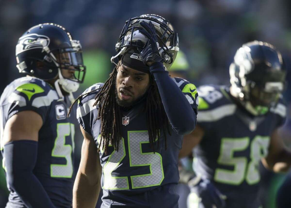 Cornerback Richard Sherman #25 of the Seattle Seahawks walks off the field before the football game against the San Francisco 49ers at CenturyLink Field on November 22, 2015 in Seattle, Washington. The Seahawks won the game 29-13.