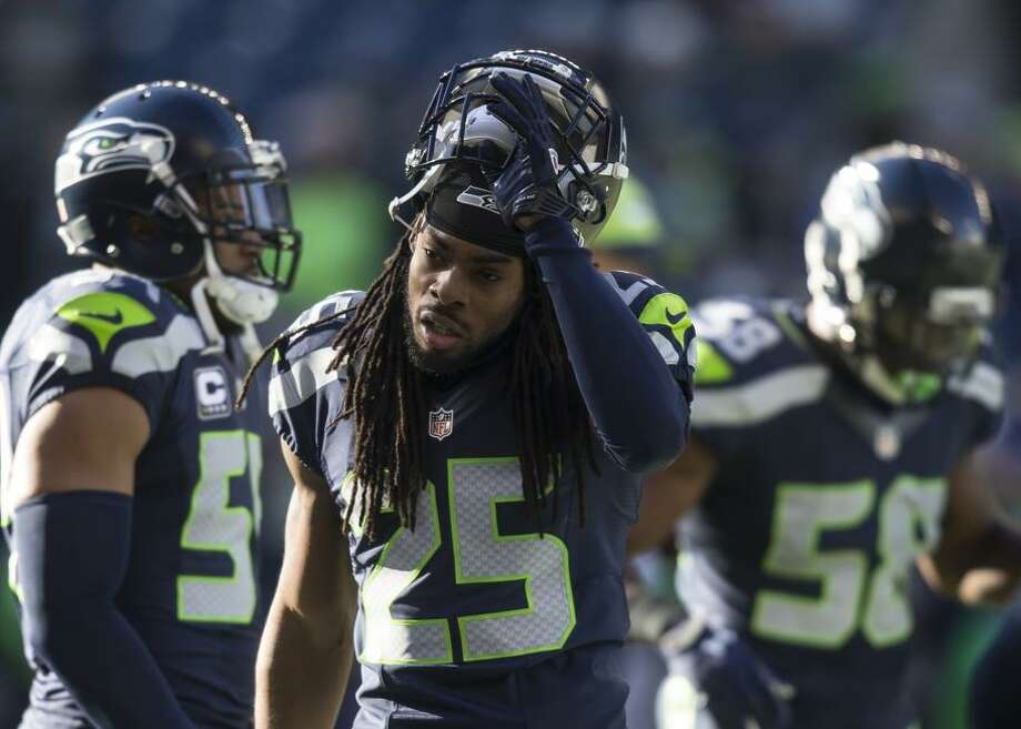 Cornerback Richard Sherman #25 of the Seattle Seahawks walks off the field before the football game against the San Francisco 49ers at CenturyLink Field on November 22, 2015 in Seattle, Washington. The Seahawks won the game 29-13. Photo: Stephen Brashear / Getty Images / 2015 Getty Images
