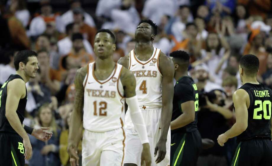 Texas forward Mohamed Bamba (4) and guard Kerwin Roach II (12) walk off the court during an NCAA college basketball game against Baylor, Monday, Feb. 12, 2018, in Austin, Texas. Baylor won 74-73 in double overtime. (AP Photo/Eric Gay) Photo: Eric Gay, STF / Associated Press / Copyright 2018 The Associated Press. All rights reserved.