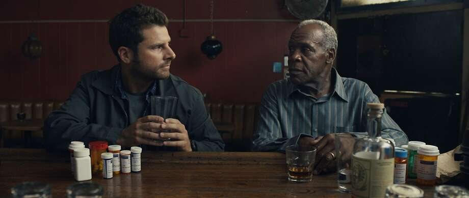 "James Roday (left) and Danny Glover in the comedy ""Pushing Dead."" Writer/director Tom E. Brown will answer questions at the Roxie. Photo: Frameline"