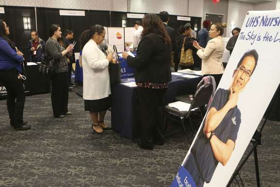 People ask questions about employment opportunities at University Health System during a Mega Career Fair at the Norris Conference Center on Loop 410.