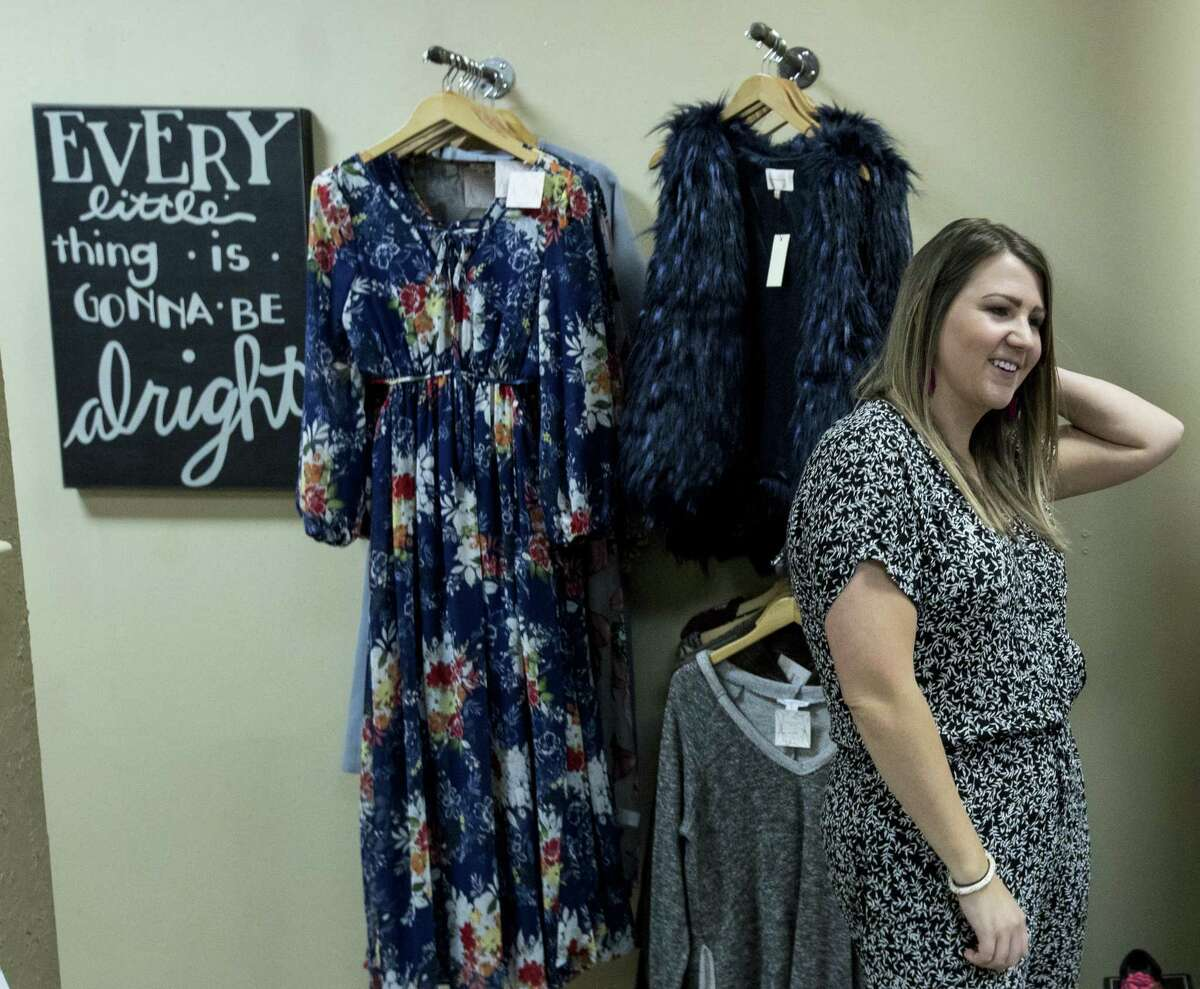 Nikole Davis, owner of Pretty Little Things boutique, works in her pop-up store on Thursday, Feb. 22, 2018, in Atascocita. Davis' Kingwood store took on six feet of water in the aftermath of Hurriane Harvey. She opened a pop-up shop, in nearby Atascocita, and expanded her online business to keep selling her merchandise while she rebuilds her store. ( Brett Coomer / Houston Chronicle )